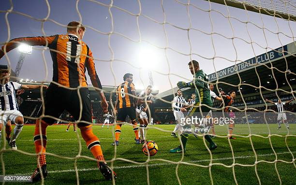 Gareth McAuley of West Bromwich Albion scores his sides second goal during the Premier League match between West Bromwich Albion and Hull City at The...