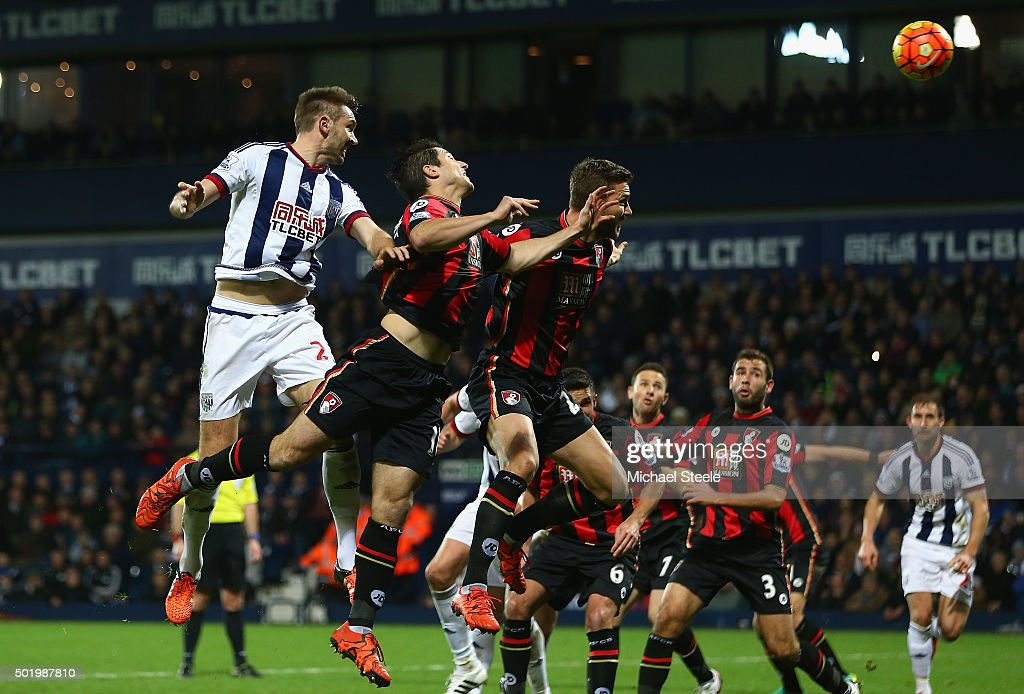 Gareth McAuley (1st L) of West Bromwich Albion scores his team's first goal during the Barclays Premier League match between West Bromwich Albion and A.F.C. Bournemouth at The Hawthorns on December 19, 2015 in West Bromwich, England.
