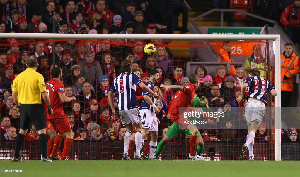 Gareth McAuley of West Bromwich Albion scores the opening goal during the Barclays Premier League match between Liverpool and West Bromwich Albion at Anfield on February 11, 2013 in Liverpool, England.