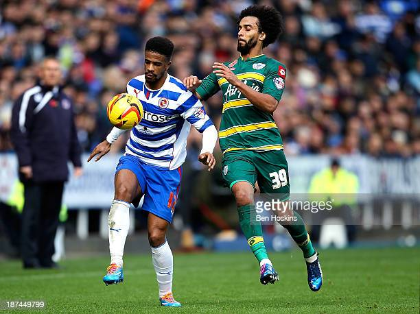 Gareth McCleary of Reading holds off pressure from Benoit AssouEkotto of QPR during the Sky Bet Championship match between Reading and Queens Park...