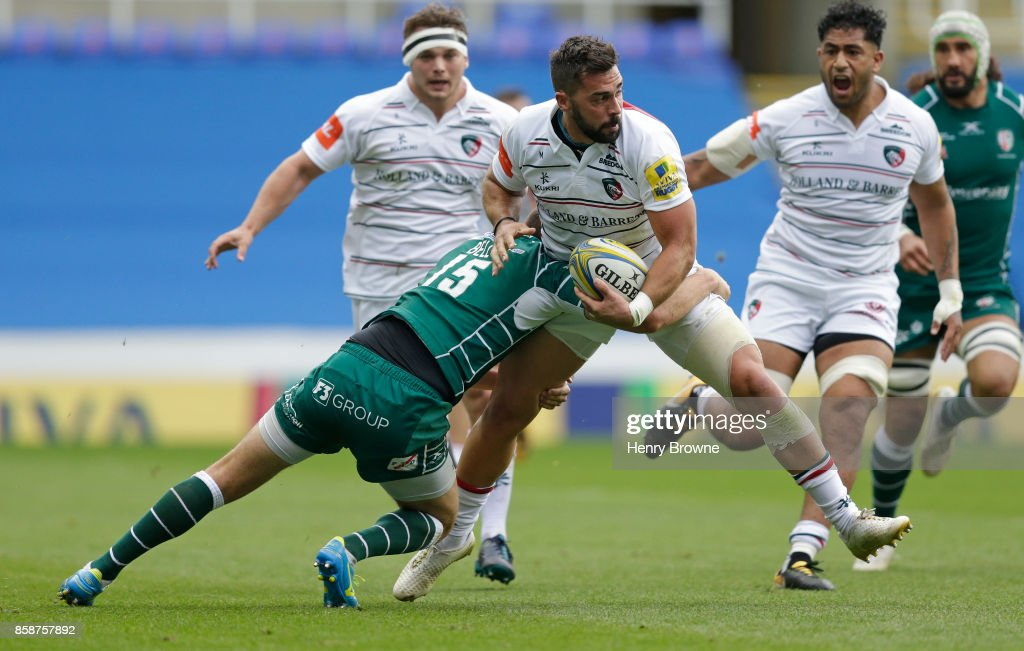 Gareth Owen of Leicester Tigers tackled by Tommy Bell of London Irish during the Aviva Premiership match between London Irish and Leicester Tigers at Madejski Stadium on October 7, 2017 in Reading, England.