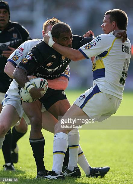 Gareth Raynor of Hull is held up by Lee Briers and Chris Riley of Warrington during the Engage Super League match between Warrington Wolves and Hull...