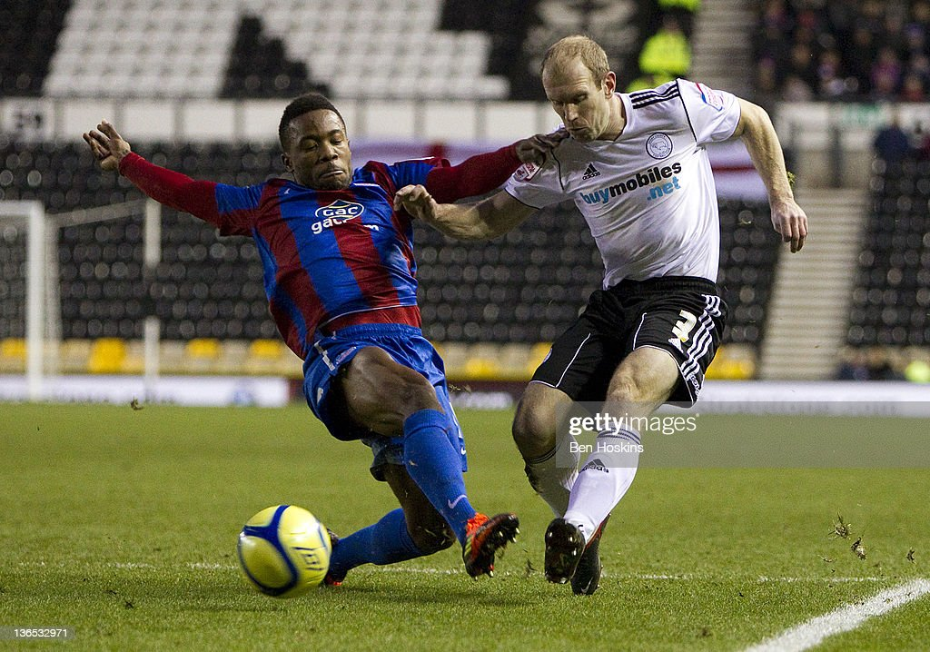 Gareth Roberts of Derby crosses the ball ahead of Mustapha Dumbuya of Crystal Palace during the FA Cup sponsored by Budweiser Third Round match between Derby County FC and Crystal Palace FC at Pride Park on January 7, 2012 in Derby, England.