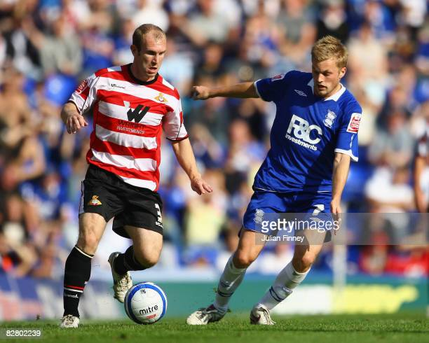 Gareth Roberts of Doncaster holds off Sebastian Larsson of Birmingham City during the Coca Cola Championship match between Birmingham City and...