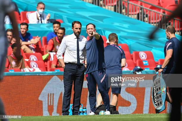 Gareth Southgate, Head Coach of England and Steve Holland , Assistant Coach of England look on during the UEFA Euro 2020 Championship Group D match...