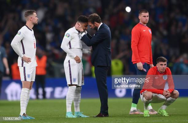 Gareth Southgate, Head Coach of England consoles Jadon Sancho following defeat in the UEFA Euro 2020 Championship Final between Italy and England at...