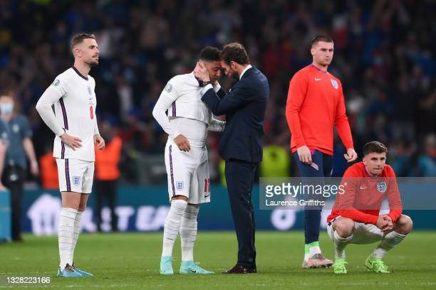 Gareth Southgate, Head Coach of England consoles Jadon Sancho of England following defeat in the UEFA Euro 2020 Championship Final between Italy and...