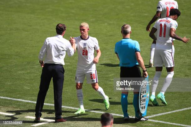 Gareth Southgate, Head Coach of England greets Phil Foden of England as he is substituted off during the UEFA Euro 2020 Championship Group D match...