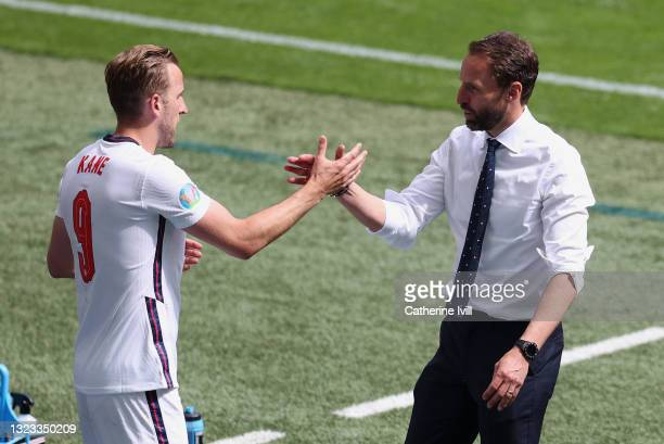 Gareth Southgate, Head Coach of England shakes hands with Harry Kane of England following victory in the UEFA Euro 2020 Championship Group D match...