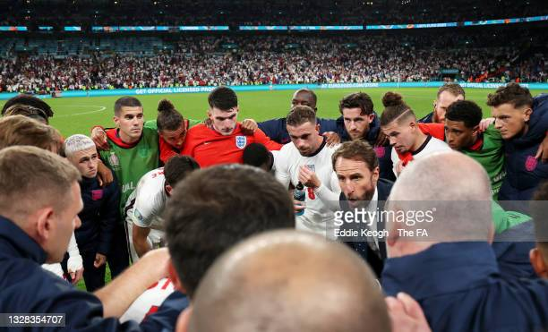 Gareth Southgate, Head Coach of England speaks to his players in a huddle at half time in extra-time during the UEFA Euro 2020 Championship Final...