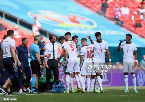 Gareth Southgate, Head Coach of England speaks with his players during a break in play during the UEFA Euro 2020 Championship Group D match between...