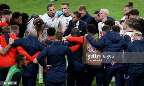 Gareth Southgate, Head Coach of England speaks with his team during a team huddle at half time of extra time during the UEFA Euro 2020 Championship...