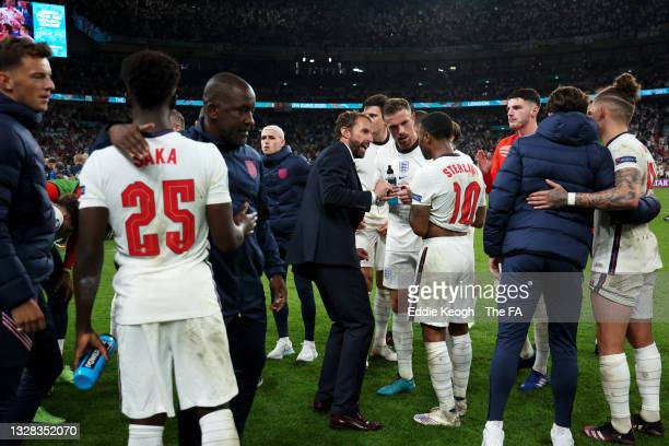 Gareth Southgate, Head Coach of England speaks with Jordan Henderson and Raheem Sterling of England during a team talk during the UEFA Euro 2020...