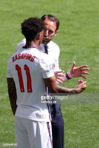 Gareth Southgate, Head Coach of England speaks with Marcus Rashford of England before he enters the pitch as a substitute during the UEFA Euro 2020...
