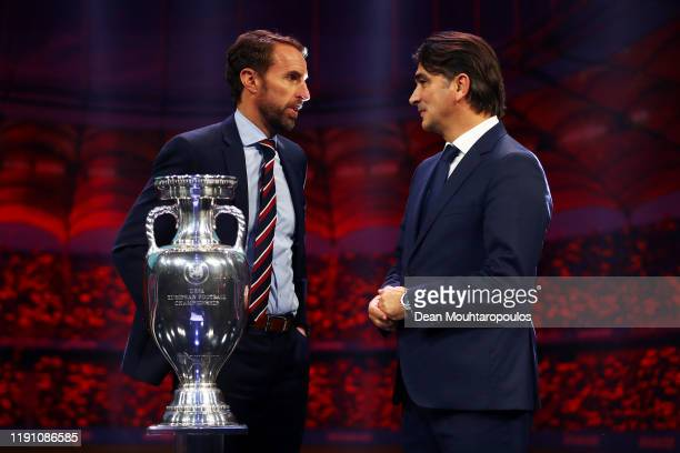 Gareth Southgate Head Coach of England speaks with Zlatko Dalic Head Coach of Croatia after the UEFA Euro 2020 Final Draw Ceremony at the Romexpo on...