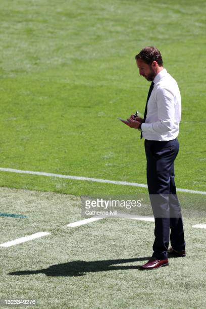 Gareth Southgate, Head Coach of England takes notes during the UEFA Euro 2020 Championship Group D match between England and Croatia at Wembley...