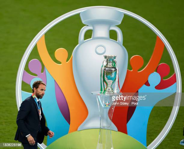 Gareth Southgate, Head Coach of England walks past the Henri Delaunay Trophy following his team's defeat in the UEFA Euro 2020 Championship Final...