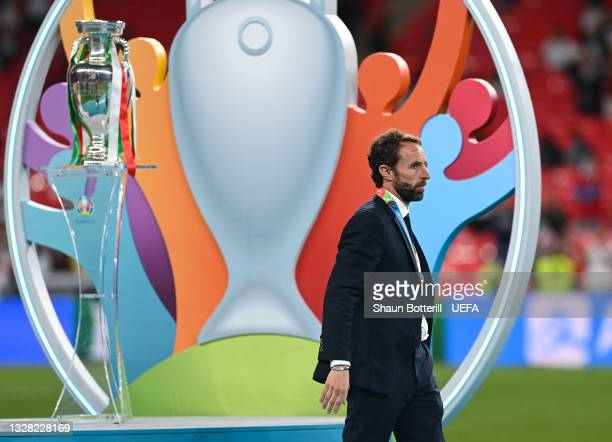 Gareth Southgate, Head Coach of England walks past the The Henri Delaunay Trophy with his runners-up medal following his team's defeat in the UEFA...