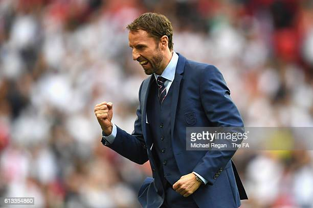 Gareth Southgate, Interim Manager of England celebrates after Daniel Sturridge scores his sides first goal during the FIFA 2018 World Cup Qualifier...