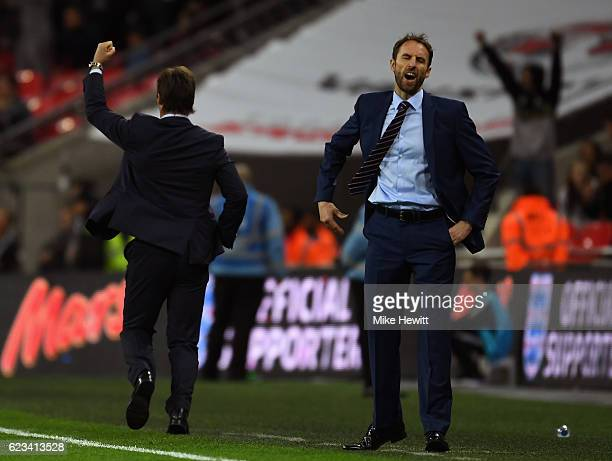 Gareth Southgate interim manager of England reacts as Julen Lopetegui head coach of Spain celebrates as Isco of Spain scores their second goal during...