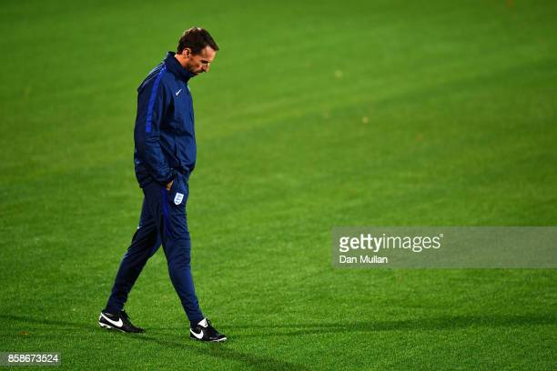 Gareth Southgate looks at the artificial grass pitch during an England Training Session at The LFF Stadium in Vilnius at a Media Access day on...