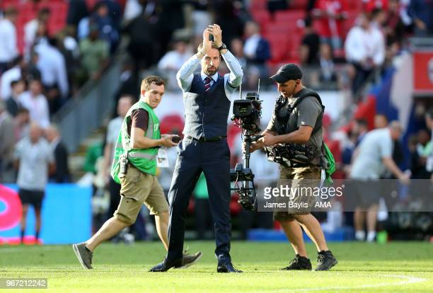 Gareth Southgate manager / head coach of England applauds at full time after the International Friendly between England and Nigeria at Wembley...