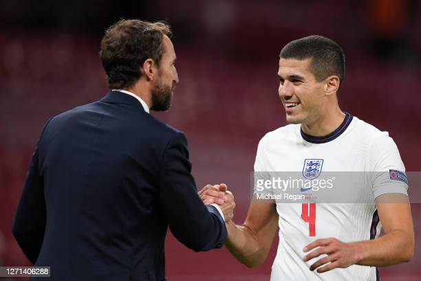 Gareth Southgate, Manager of England and Conor Coady of England shake hands following the UEFA Nations League group stage match between Denmark and...