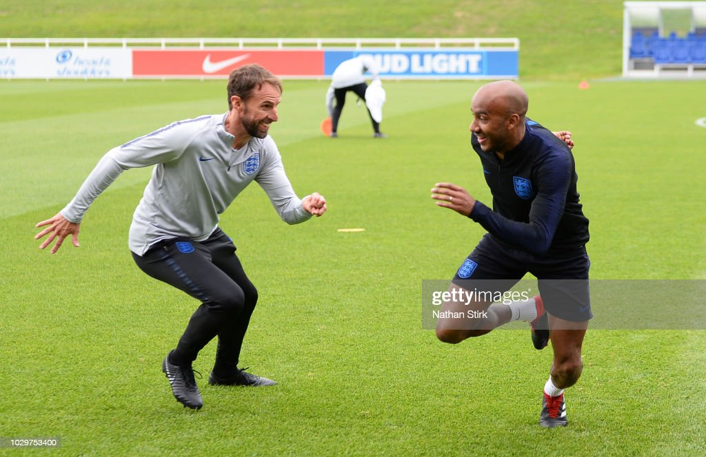 Gareth Southgate, manager of England and Fabian Delph warm up during a training session at St Georges Park on September 9, 2018 in Burton-upon-Trent, England.