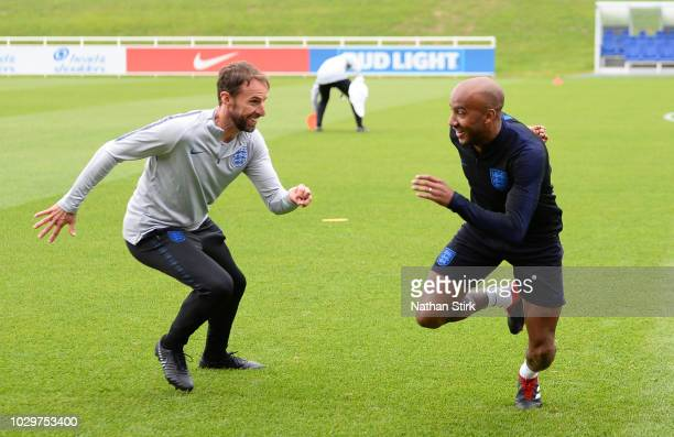 Gareth Southgate manager of England and Fabian Delph warm up during a training session at St Georges Park on September 9 2018 in BurtonuponTrent...
