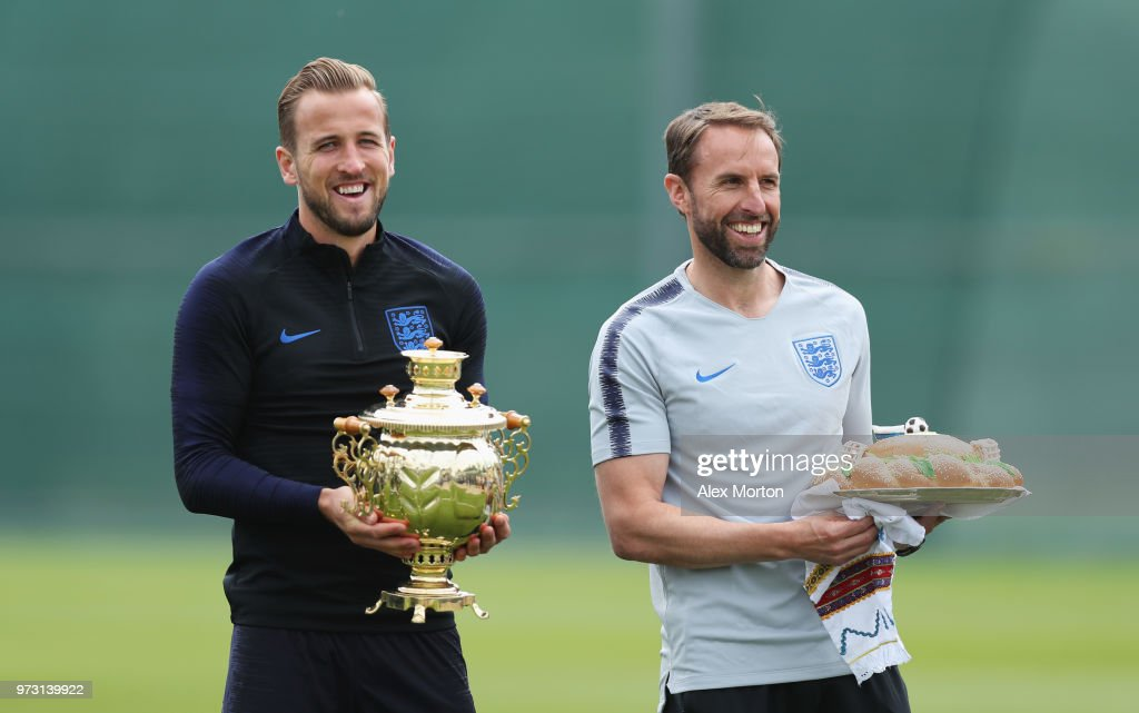 Gareth Southgate, Manager of England and Harry Kane of England a presented with gifts during a training session as part of the England media access at Spartak Zelenogorsk Stadium ahead of the FIFA World Cup 2018 on June 13, 2018 in Saint Petersburg, Russia.