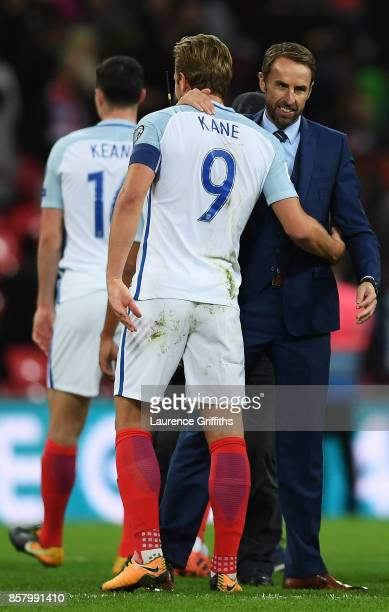 Gareth Southgate, manager of England and Harry Kane of England celebrate victory and World Cup Finals qualification after the FIFA 2018 World Cup...