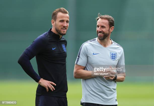 Gareth Southgate Manager of England and Harry Kane of England look on during a training session as part of the England media access at Spartak...