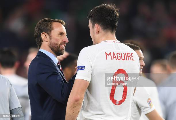 Gareth Southgate Manager of England and Harry Maguire of England celebrate victory after the UEFA Nations League A Group Four match between Spain and...