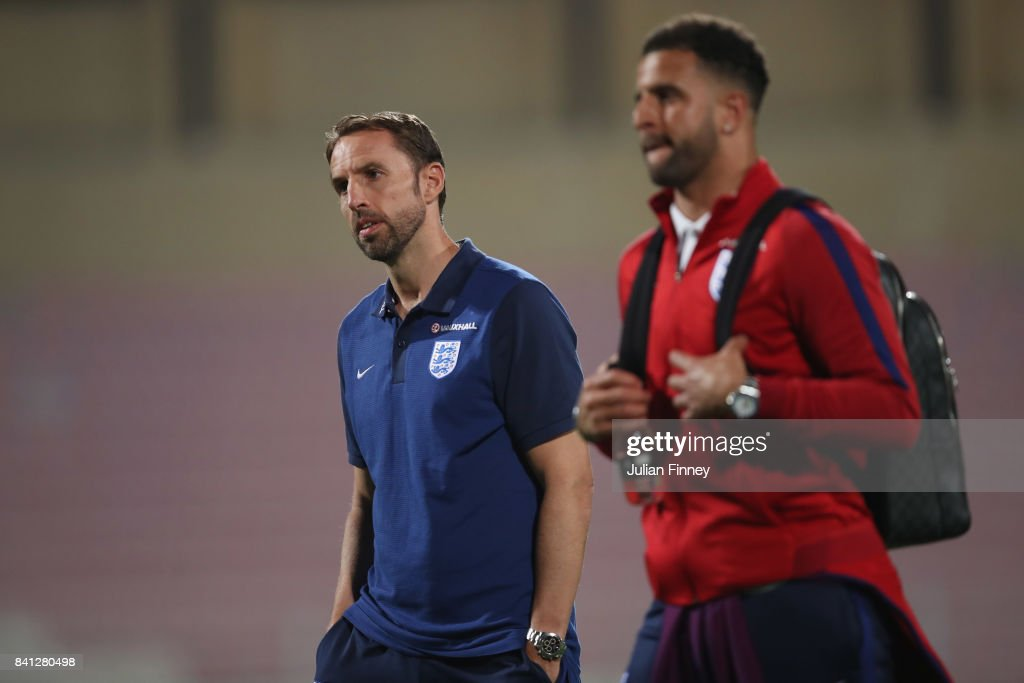 Gareth Southgate manager of England and Kyle Walker inspect the pitch on the eve of the World Cup qualifying match against Malta at Ta'Qali National Stadium on August 31, 2017 in Valletta, Malta.