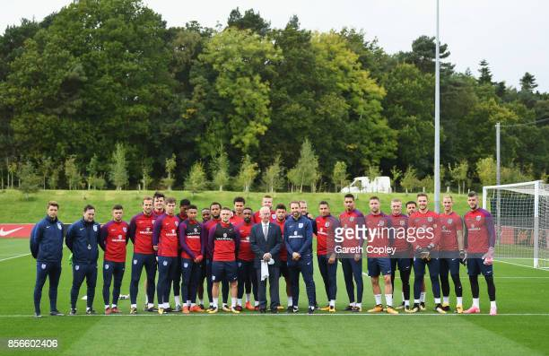 Gareth Southgate manager of England and players pose with Sir Bobby Charlton as a pitch is name in his honour during an England training session at...