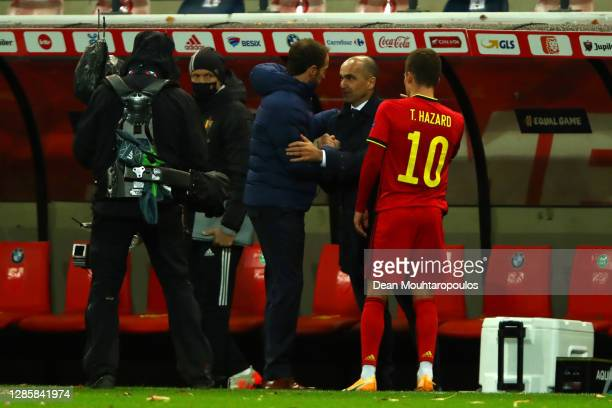 Gareth Southgate, Manager of England and Roberto Martinez, Head Coach of Belgium interact following the UEFA Nations League group stage match between...