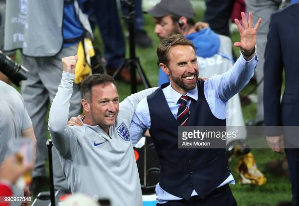Gareth Southgate Manager of England celebrates victory with his assistant Steve Holland following the 2018 FIFA World Cup Russia Round of 16 match...