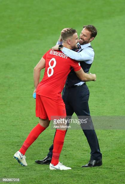 Gareth Southgate Manager of England celebrates victory with Jordan Henderson following the 2018 FIFA World Cup Russia Round of 16 match between...