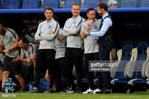 Gareth Southgate Manager of England celebrates with coaching staff following victory during the 2018 FIFA World Cup Russia Quarter Final match...