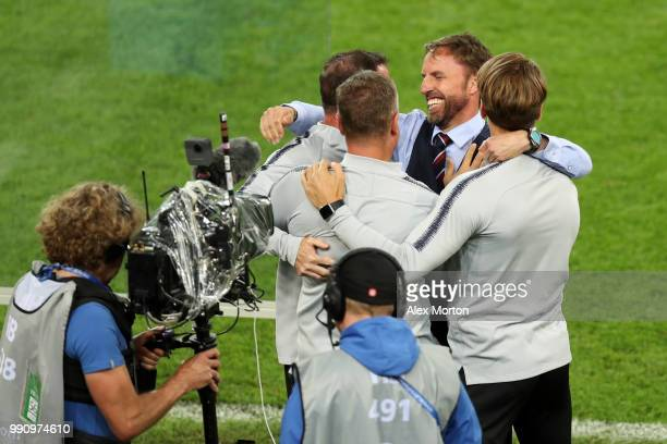 Gareth Southgate Manager of England celebrates with his coaching staff following the 2018 FIFA World Cup Russia Round of 16 match between Colombia...