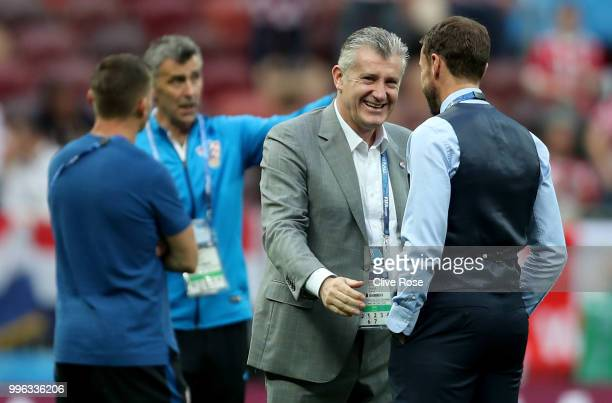 Gareth Southgate Manager of England cheers former striker Davor Suker during a pitch inspection prior to the 2018 FIFA World Cup Russia Semi Final...