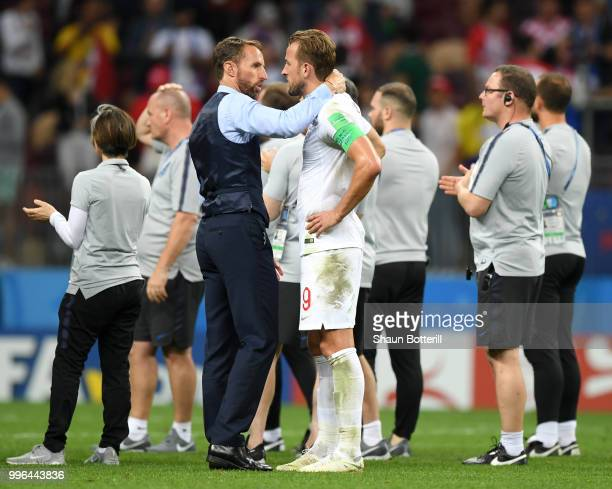 Gareth Southgate Manager of England consoles Harry Kane of England following their sides defeat in the 2018 FIFA World Cup Russia Semi Final match...