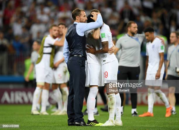 Gareth Southgate Manager of England consoles Marcus Rashford of England following their sides defeat in the 2018 FIFA World Cup Russia Semi Final...