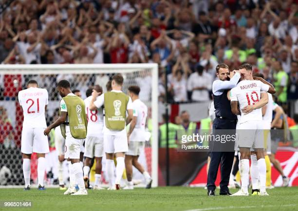 Gareth Southgate Manager of England embraces Marcus Rashford of England after the 2018 FIFA World Cup Russia Semi Final match between England and...