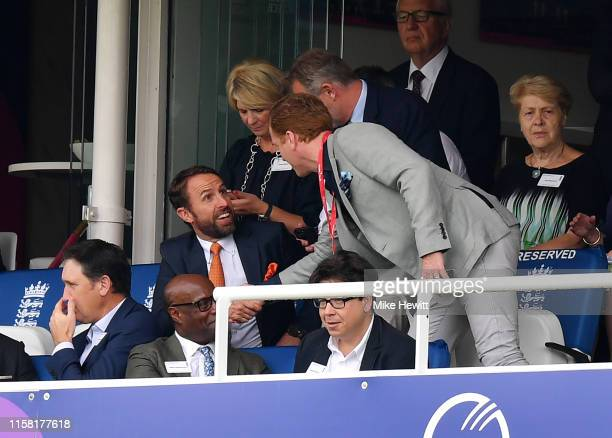 Gareth Southgate, Manager of England football greets Actor, Damian Lewis as Comedian, Michael McIntyre watches the action during the Group Stage...