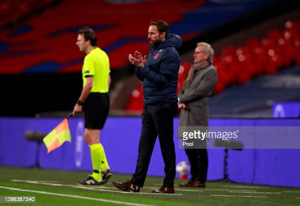 Gareth Southgate, Manager of England gives their team instructions during the UEFA Nations League group stage match between England and Iceland at...