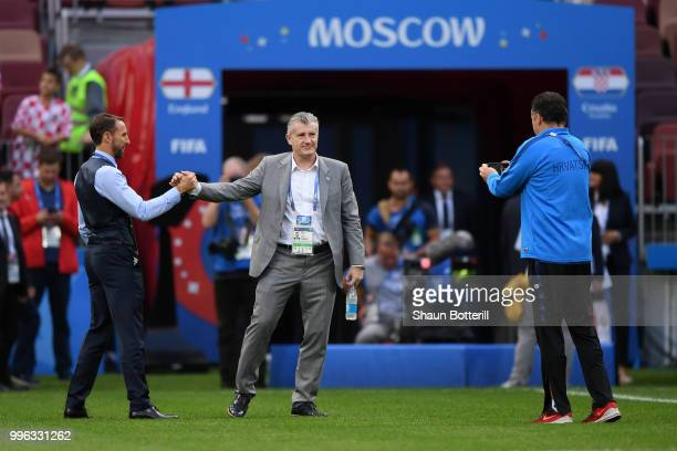 Gareth Southgate Manager of England greets Former Croatia player Davor Suker during a pitch inspection prior to the 2018 FIFA World Cup Russia Semi...
