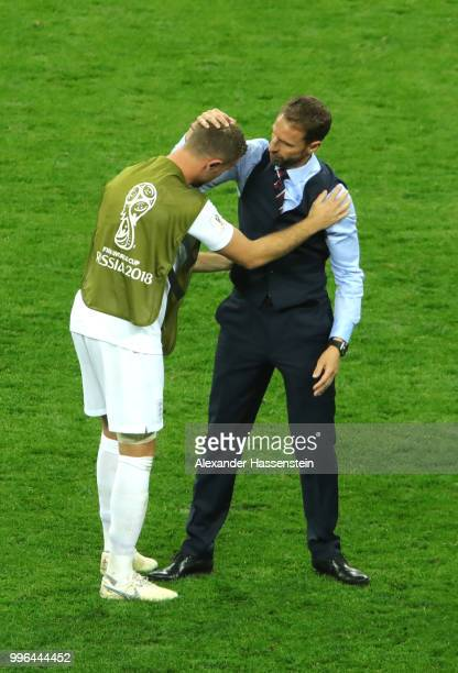 Gareth Southgate Manager of England hugs Jordan Henderson following their team's defeat in the 2018 FIFA World Cup Russia Semi Final match between...