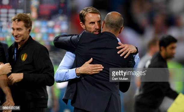 Gareth Southgate Manager of England hugs Roberto Martinez Head coach of Belgium following the 2018 FIFA World Cup Russia group G match between...