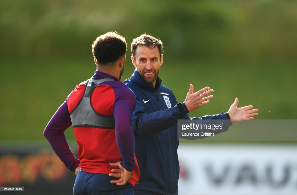 Gareth Southgate manager of England in discussion with Kyle Walker during a training session as part of England media access at St George's Park on June 6, 2017 in Burton-upon-Trent, England.
